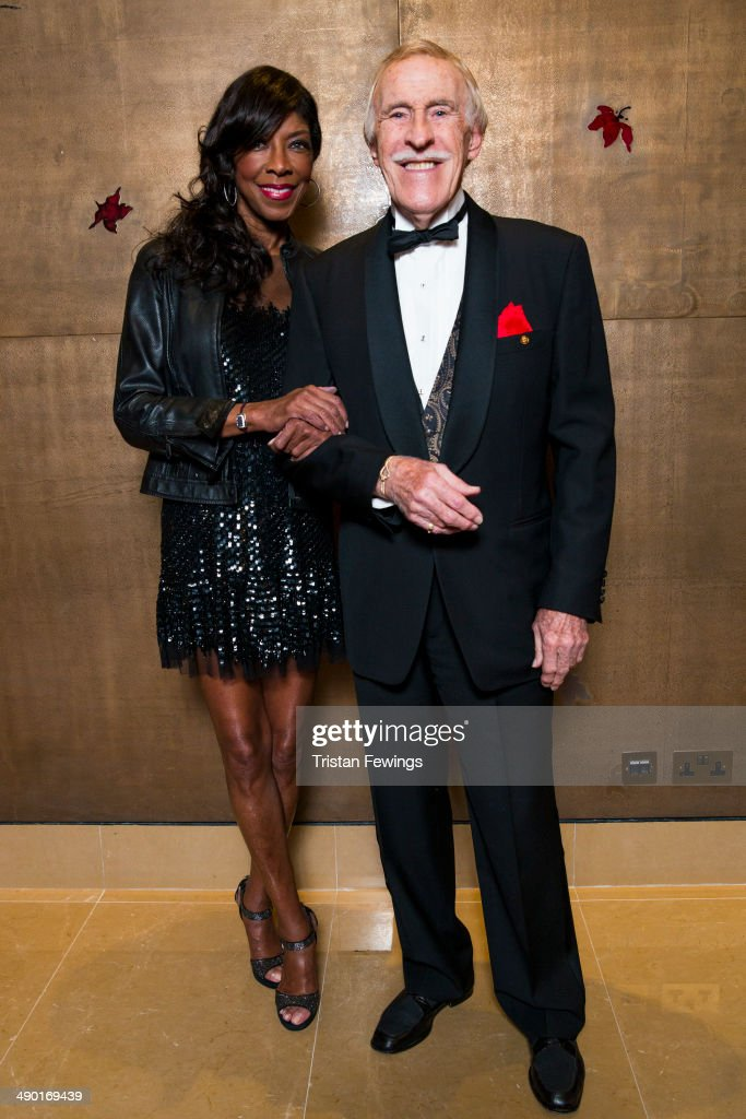 Natalie Cole and Bruce Forsyth attend the premiere for 'Nat King Cole: Afraid Of the Dark' at The Mayfair Hotel on May 13, 2014 in London, England.