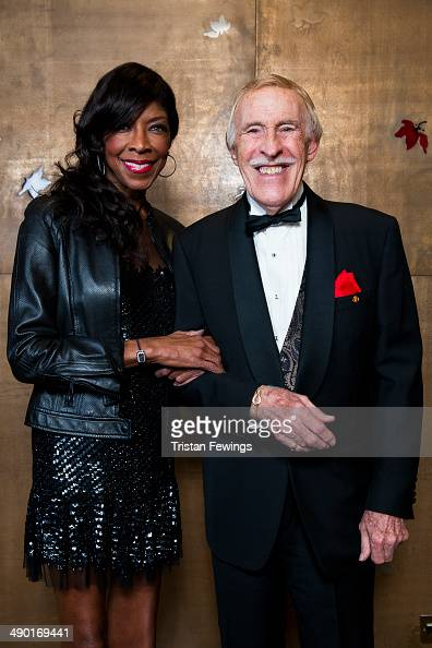 Natalie Cole and Bruce Forsyth attend the premiere for 'Nat King Cole Afraid Of the Dark' at The Mayfair Hotel on May 13 2014 in London England