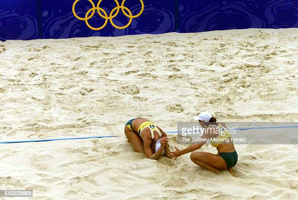 Natalie Cook and Kerri Pottharst of Australia rejoice after winning the final point that wins them the Sydney 2000 Olympic Games beach volleyball...