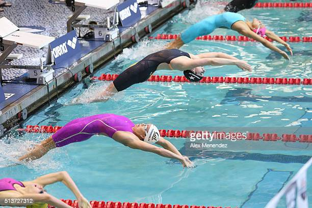Natalie Coughlin and Missy Franklin leap from the starting block during day two of the Arena Pro Swim Series at the YMCA of Central Florida Aquatic...