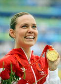 Natalie Coughlin of the United States poses with the gold medal during the medal ceremony for the Women's 100m Backstroke held at the National...