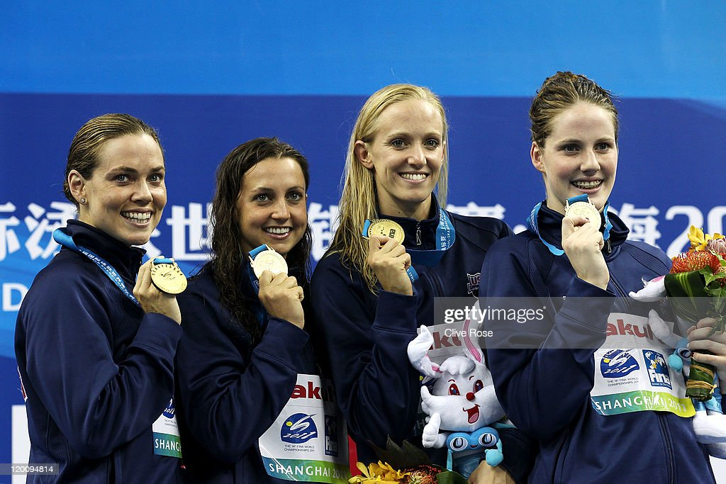 <a gi-track='captionPersonalityLinkClicked' href=/galleries/search?phrase=Natalie+Coughlin+-+Swimmer&family=editorial&specificpeople=171726 ng-click='$event.stopPropagation()'>Natalie Coughlin</a>, <a gi-track='captionPersonalityLinkClicked' href=/galleries/search?phrase=Rebecca+Soni&family=editorial&specificpeople=695876 ng-click='$event.stopPropagation()'>Rebecca Soni</a>, <a gi-track='captionPersonalityLinkClicked' href=/galleries/search?phrase=Dana+Vollmer&family=editorial&specificpeople=240582 ng-click='$event.stopPropagation()'>Dana Vollmer</a> and Melissa Franklin of the United States pose with their gold medals in the Women's 4x100m Medley Relay during Day Fifteen of the 14th FINA World Championships at the Oriental Sports Center on July 30, 2011 in Shanghai, China.