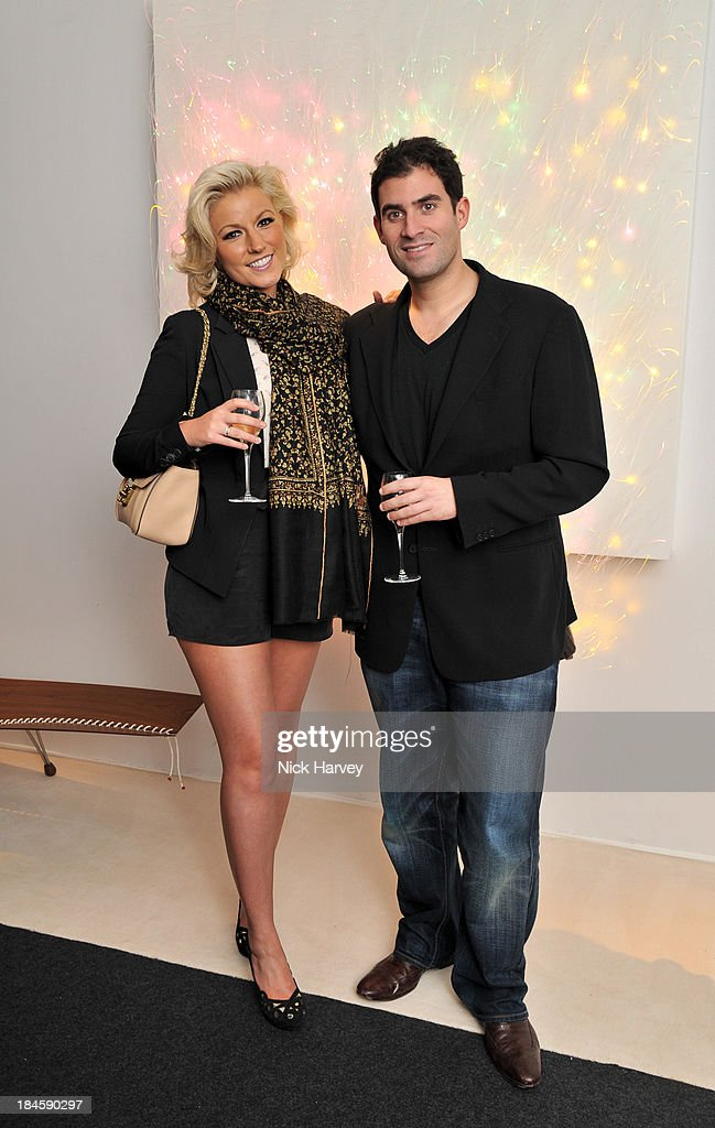 Natalie Coyle and Zafar Rushie attend the collectors preview for PAD London at Berkeley Square Gardens on October 14, 2013 in London, England.