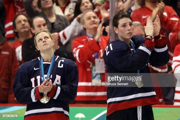 Natalie Darwitz and Hilary Knight of the United States receive their silver medals following the ice hockey women's gold medal game between Canada...