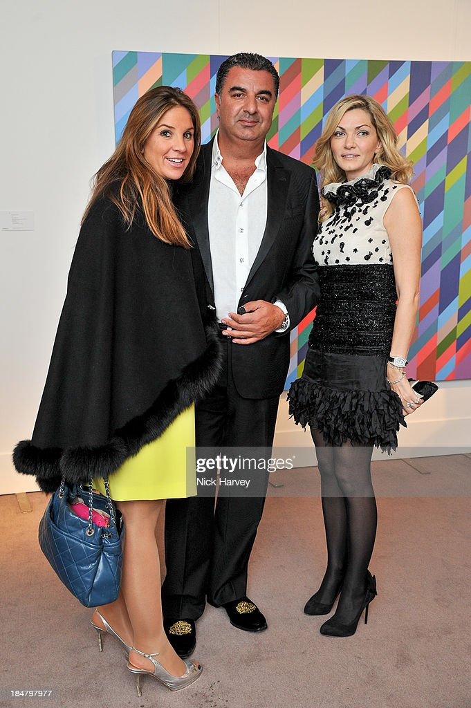 Natalie D'auriac, Kam Babaee and Reem Debs attend Mimi Foundation 'The Power of Love' gala dinner and auction at Sotheby's on October 16, 2013 in London, England.