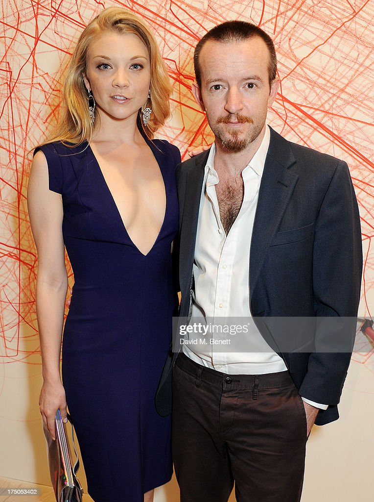 Natalie Dormer (L) and Anthony Byrne attend a private view of 'HUGO: Red Never Follows', celebrating 20 years of Hugo Boss, at the Saatchi Gallery on July 30, 2013 in London, England.
