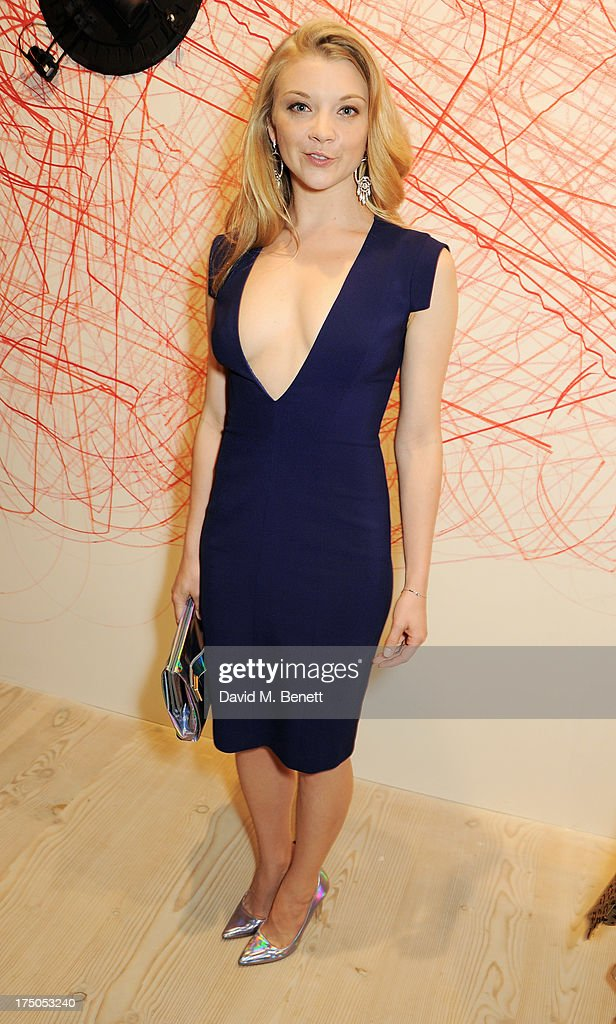 Natalie Dormer attends a private view of 'HUGO: Red Never Follows', celebrating 20 years of Hugo Boss, at the Saatchi Gallery on July 30, 2013 in London, England.