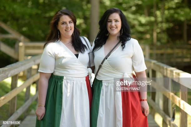 Natalie Falcone 27 and her fraternal twin Michelle both from Pittsburgh pose for a portrait at the 42nd Annual Twins Days Festival in Twinsburg Ohio...