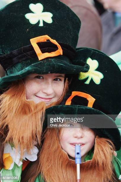 Natalie Giarino and Norana Giarino join in the St Patrick's Day march on March 13 2005 in London England Around 25000 people are expected to attend...