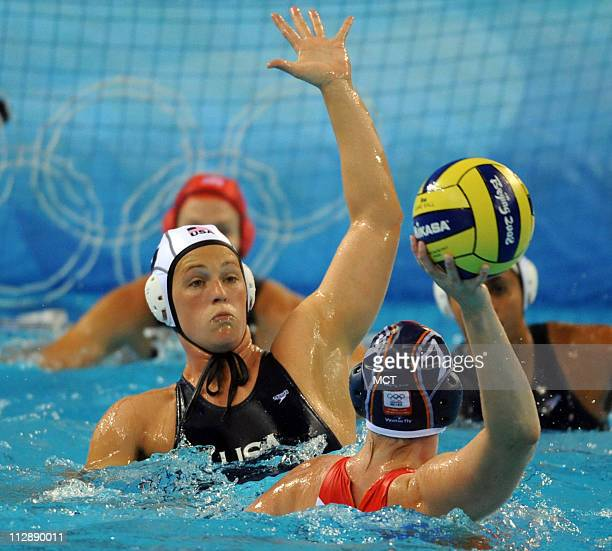 Natalie Golda of the United States left defends against Iefke van Belkum of the Netherlands in the gold medal match in water polo on Thursday August...
