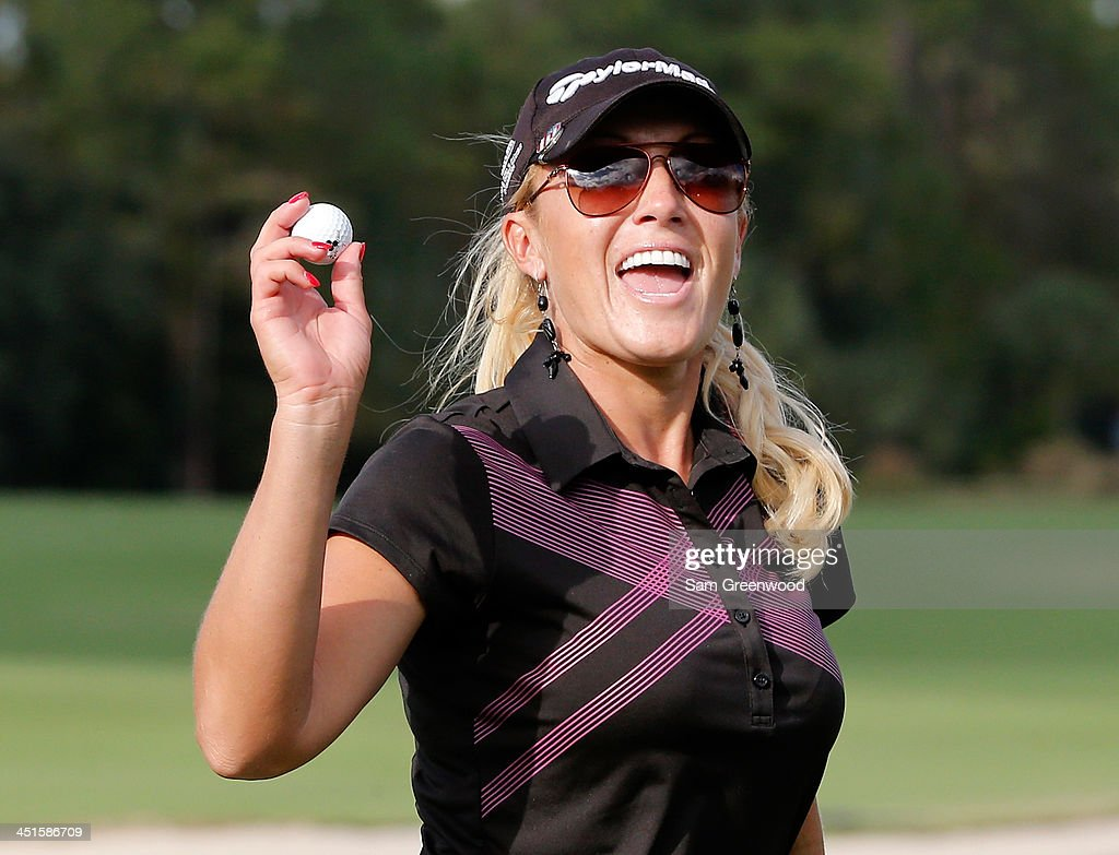 Natalie Gulbis acknowledges the crowd on the 17th hole during the third round of the CME Group Titleholders at Tiburon Golf Club on November 23, 2013 in Naples, Florida.