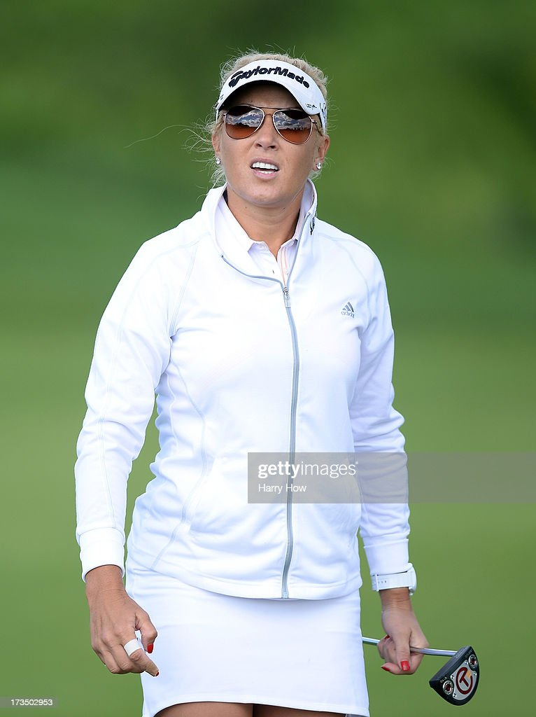 <a gi-track='captionPersonalityLinkClicked' href=/galleries/search?phrase=Natalie+Gulbis&family=editorial&specificpeople=179451 ng-click='$event.stopPropagation()'>Natalie Gulbis</a> leaves the third green during round one of the Manulife Financial LPGA Classic at the Grey Silo Golf Course on July 11, 2013 in Waterloo, Canada.