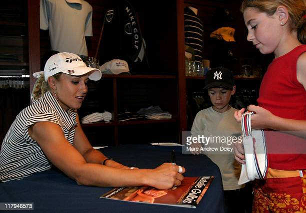Natalie Gulbis signs her new 16month 2005 calendar on July 9th 2004 at the Canadian Women's Open This comes just a week after the United States Golf...