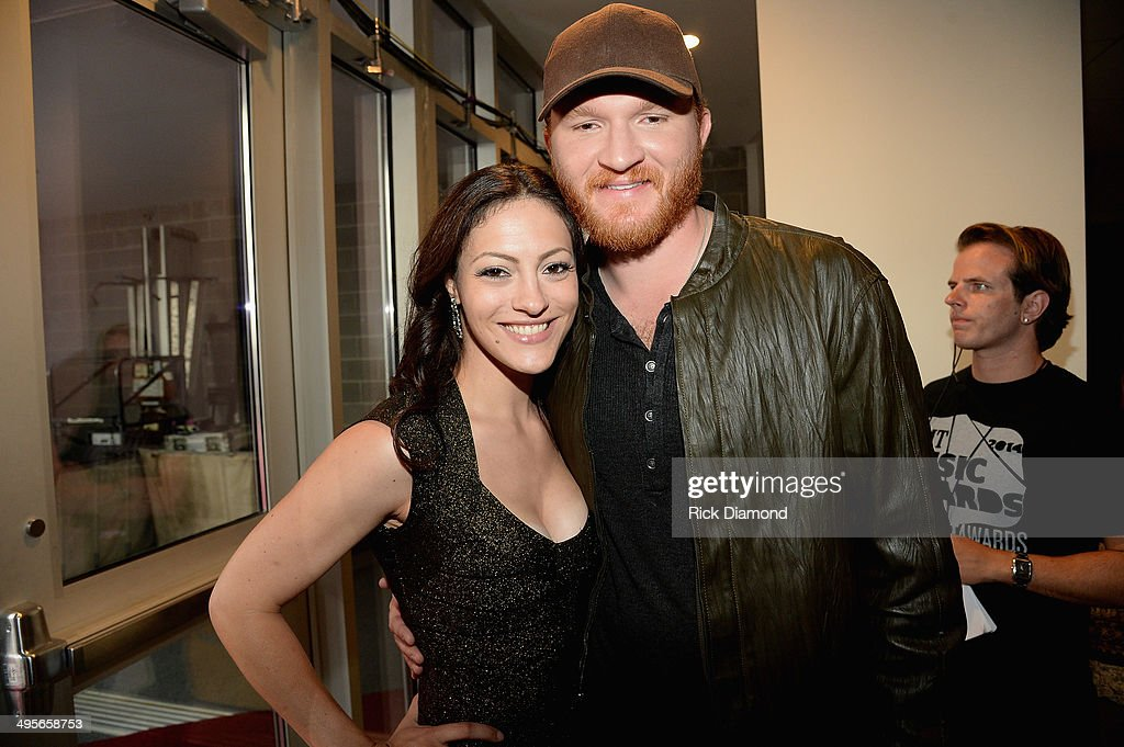 Natalie Harker and Eric Paslay attend the 2014 CMT Music Awards at Bridgestone Arena on June 4 2014 in Nashville Tennessee
