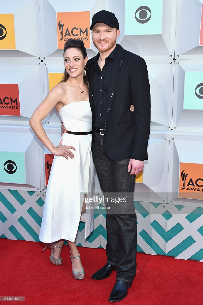 Natalie Harker and singer Eric Paslay attend the 51st Academy of Country Music Awards at MGM Grand Garden Arena on April 3 2016 in Las Vegas Nevada