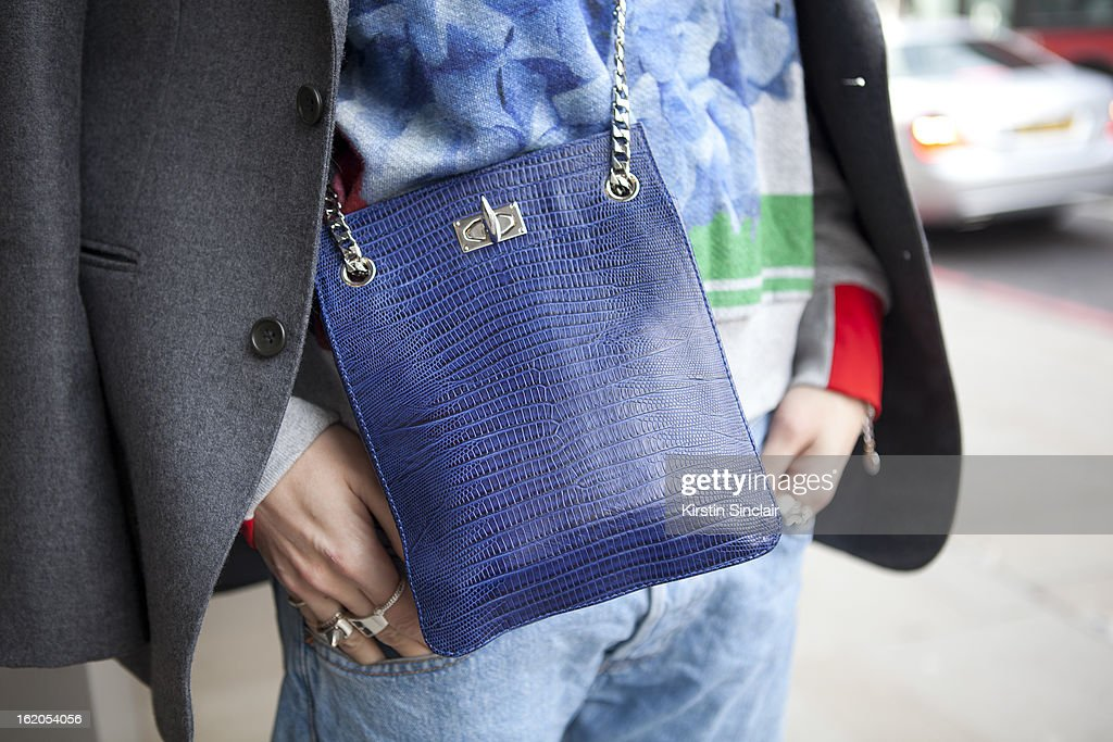 Natalie Hartley wears vintage jacket, Preen top and Givenchy cross body purse on day 3 of London Womens Fashion Week Autumn/Winter 2013 on February 17, 2013 in London, England.