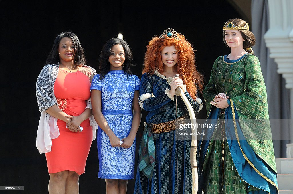 Natalie Hawkins and her daughter, gymnastics gold medalist Gabby Douglas, the brave and passionate Disney Princess Merida and Queen Elinor pose during a royal celebration at the Magic Kingdom at Walt Disney World Resort in conjunction with Mother's Day festivities on May 11, 2013 in Lake Buena Vista, Florida.