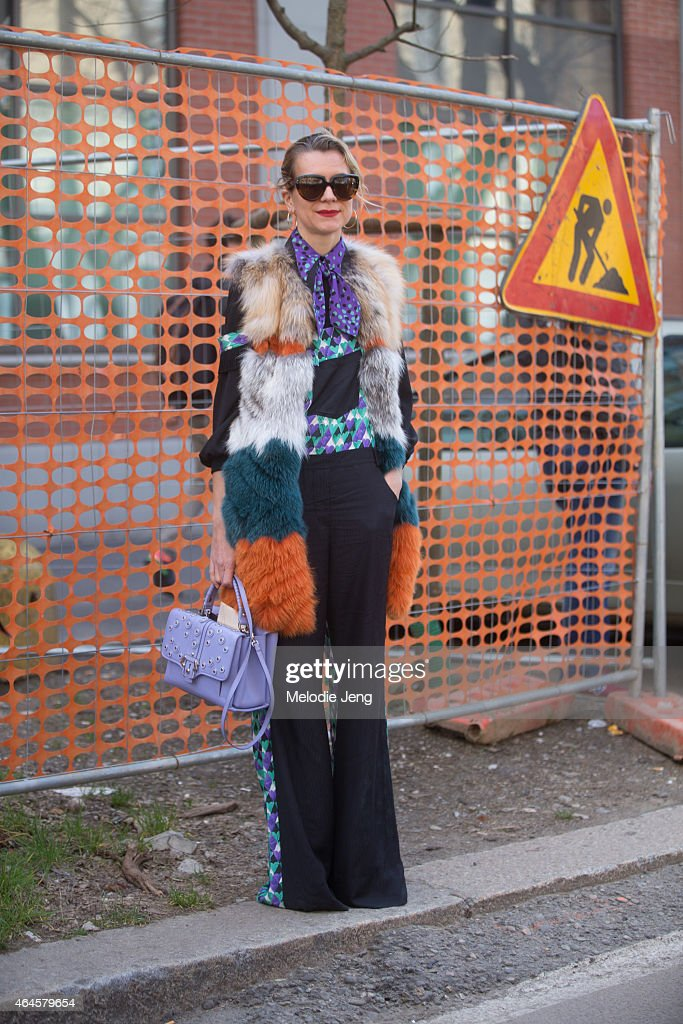 Natalie Joos wears a Just Cavalli outfit with a Paula Demartori bag> on February 26 2015 in Milan Italy