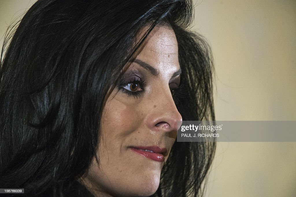 Natalie Khawam listens as her attornedy Gloria Allred (not seen) conducts a press conference on November 20, 2012, at the Ritz-Carlton hotel in Washington. Khawam is the twin sister of Tampa, Florida, socialite Jill Kelley and wanted to correct misconceptions about her and her relationship with General David Petraeus and his wife Holly. AFP PHOTO/Paul J. Richards