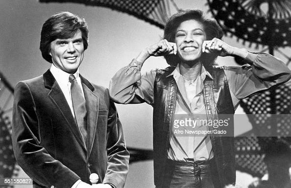 Natalie Maria Cole an AfricanAmerican singer songwriter and performer and the daughter of Nat King Cole on television with another person mid to late...