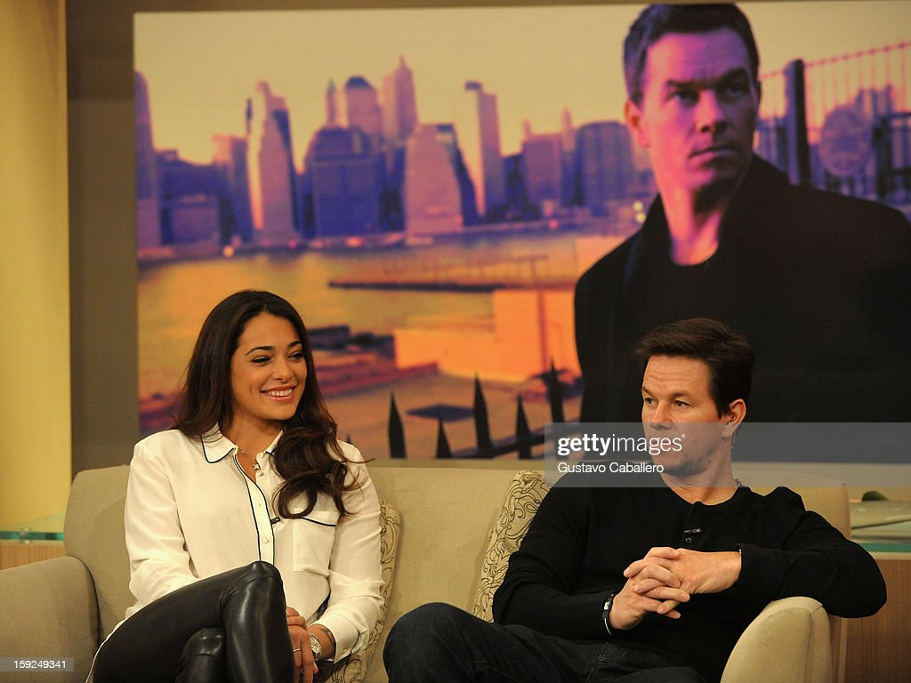 Natalie Martinez and <a gi-track='captionPersonalityLinkClicked' href=/galleries/search?phrase=Mark+Wahlberg&family=editorial&specificpeople=202265 ng-click='$event.stopPropagation()'>Mark Wahlberg</a> on The Set Of Despierta America to promote new film 'Broken City' at Univision Headquarters on January 10, 2013 in Miami, Florida.