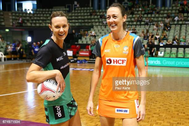 Natalie Medhurst of the Fever and Bec Bulley of the Giants look on before the coin toss during the round 10 Super Netball match between the Fever and...