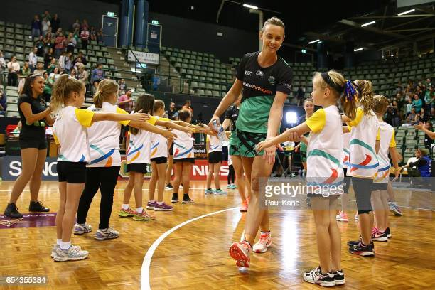 Natalie Medhurst of the Fever leads her team onto the court during the round five Super Netball match between the Fever and the Swifts at HBF Stadium...