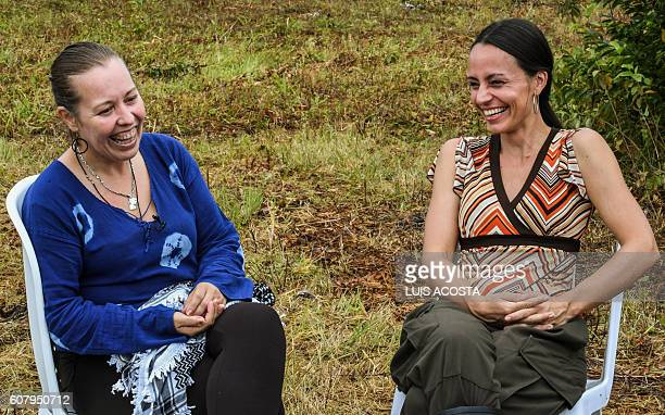 Natalie Mistral from France and Tanja Nijmeijer from Holland members of the Revolutionary Armed Forces of Colombia gesture during an interview whit...