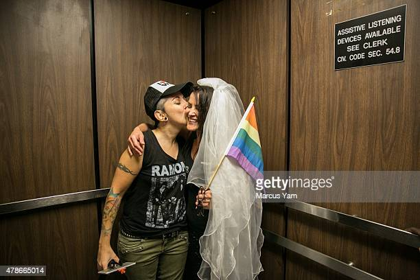 Natalie Novoa and Eddie Daniels embrace after getting married at the LA County Registrar office on June 26 2015 in Beverly Hills California The...