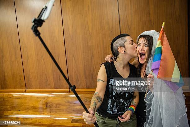 Natalie Novoa and Eddie Daniels take a selfie while waiting to get married at the LA County Registrar office on June 26 2015 in Beverly Hills...