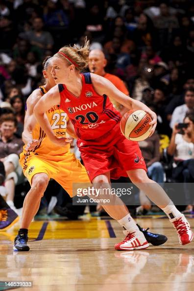 Natalie Novosel of the Washington Mystics drives against Coco Miller of the Los Angeles Sparks at the Staples Center on June 18 2012 in Los Angeles...