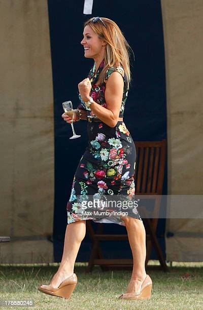 Natalie Pinkham cheers as she walks to the players tent to see Prince Harry after he played in the Audi Polo Challenge at Coworth Park Polo Club on...