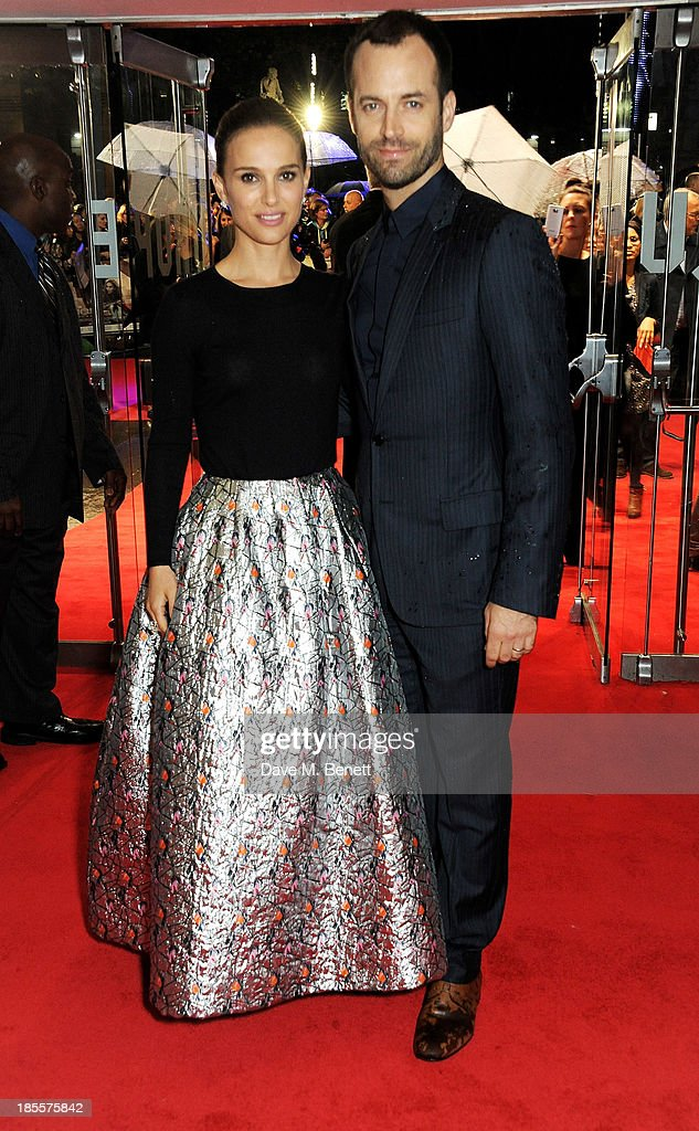 Natalie Portman (L) and Benjamin Millepied attends the World Premiere of 'Thor: The Dark World' at Odeon Leicester Square on October 22, 2013 in London, England.