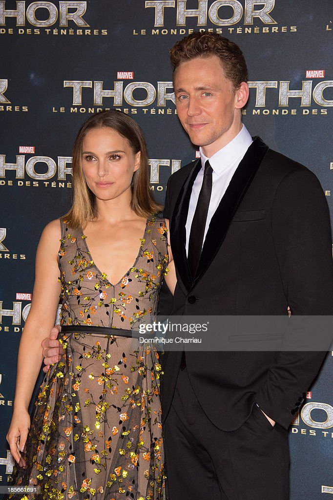 Natalie Portman and Tom Hiddleston attend the 'Thor: The Dark World' Paris Premiere at Le Grand Rex on October 23, 2013 in Paris, France.