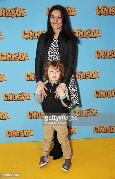 Natalie Sawyer and son attend a VIP screening of 'Robinson Crusoe' at the Vue West End on April 3 2016 in London England