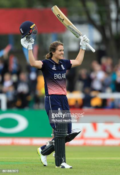 Natalie Sciver of England celebrates as she reaches her century during the Women's ICC World Cup group match between England and Pakistan at Grace...