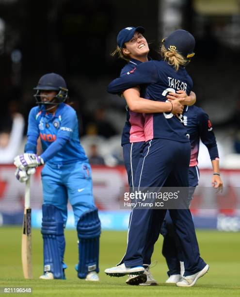 Natalie Sciver of England celebrates with Sarah Taylor of England after running out Mathali Raj of India during the ICC Women's World Cup 2017 Final...