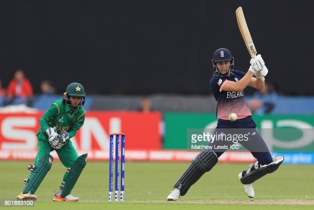 Natalie Sciver of England hits the ball towards the boundary as Sidra Nawaz of Pakistan looks on during the ICC Women's World Cup 2017 match between...