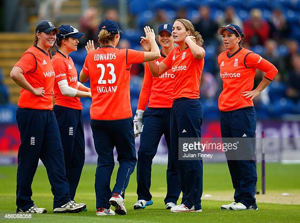Natalie Sciver of England is congratulated by team mates after Ellyse Perry of Australia is bowled out during the 3rd NatWest T20 of the Women's...