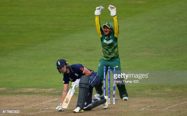 Natalie Sciver of England lies on the floor after being dismissed as Trisha Chetty of South Africa celebrates during the ICC Women's World Cup 2017...
