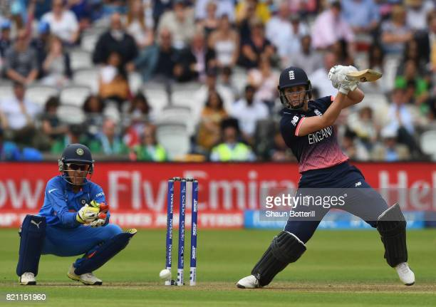 Natalie Sciver of England plays a shot as wicket keeper Sushma Verma of India looks onduring the ICC Women's World Cup 2017 Final between England and...