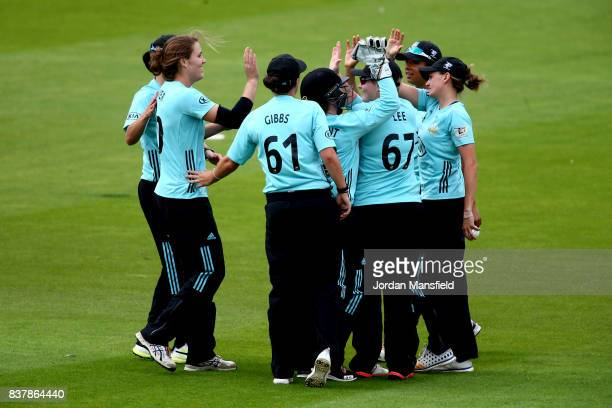 Natalie Sciver of Surrey celebrates with her teammates after dismissing Stafanie Taylor of Western Storm during the Kia Super League match between...