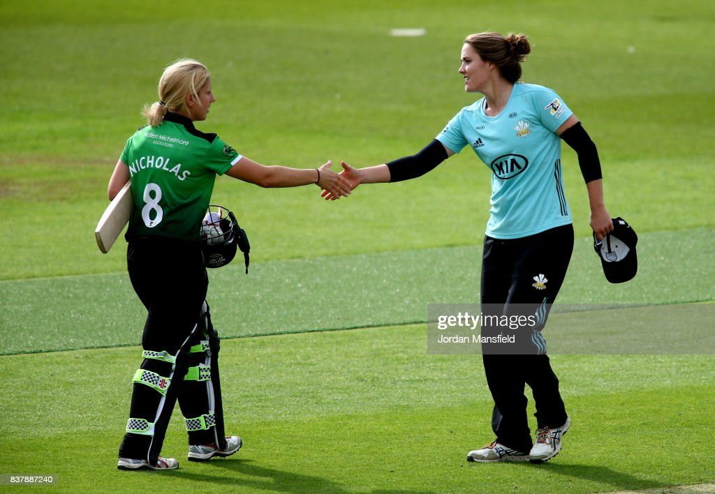 Natalie Sciver of Surrey shakes hands with Claire Nicholas of Western Storm shake hands after the Kia Super League match between Surrey Stars and Western Storm at The Kia Oval on August 23, 2017 in London, England.