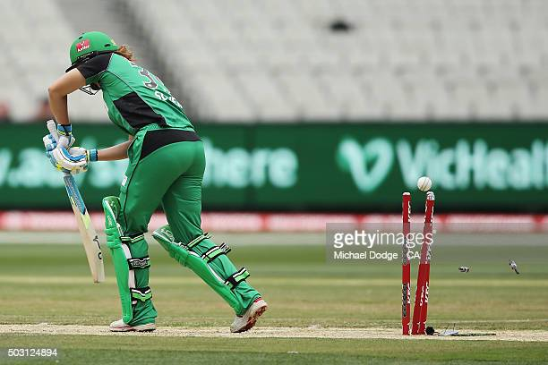 Natalie Sciver of the Stars is bowled by Shabnim Ismail of the Renegades during the Women's Big Bash League match between the Melbourne Stars and the...