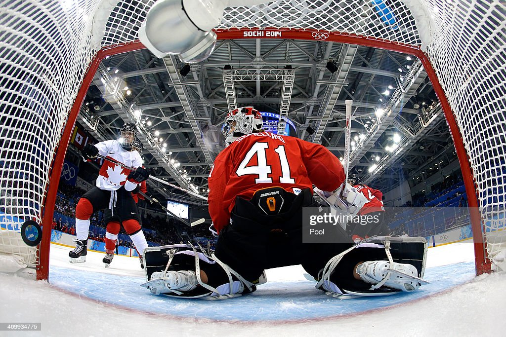 <a gi-track='captionPersonalityLinkClicked' href=/galleries/search?phrase=Natalie+Spooner&family=editorial&specificpeople=10806684 ng-click='$event.stopPropagation()'>Natalie Spooner</a> #24 of Canada scores a goal against <a gi-track='captionPersonalityLinkClicked' href=/galleries/search?phrase=Florence+Schelling&family=editorial&specificpeople=723566 ng-click='$event.stopPropagation()'>Florence Schelling</a> #41 of Switzerland in the first period during the Women's Ice Hockey Playoffs Semifinal game on day ten of the Sochi 2014 Winter Olympics at Shayba Arena on February 17, 2014 in Sochi, Russia.