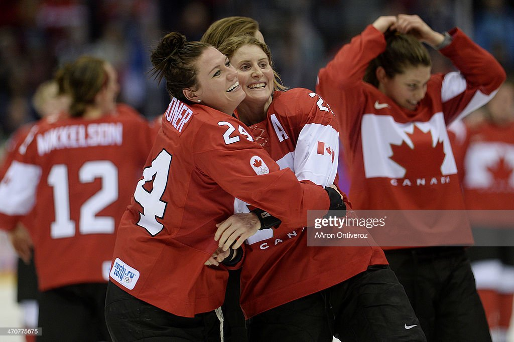 <a gi-track='captionPersonalityLinkClicked' href=/galleries/search?phrase=Natalie+Spooner&family=editorial&specificpeople=10806684 ng-click='$event.stopPropagation()'>Natalie Spooner</a> (24) of the Canada and <a gi-track='captionPersonalityLinkClicked' href=/galleries/search?phrase=Hayley+Wickenheiser&family=editorial&specificpeople=722145 ng-click='$event.stopPropagation()'>Hayley Wickenheiser</a> (22) hug after the overtime period of Canada's 3-2 gold medal ice hockey win over the U.S.A. Sochi 2014 Winter Olympics on Thursday, February 20, 2014 at Bolshoy Ice Arena.