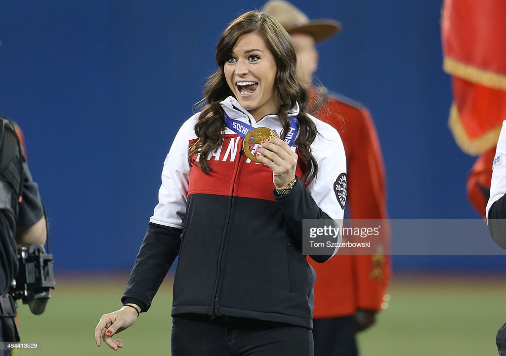 <a gi-track='captionPersonalityLinkClicked' href=/galleries/search?phrase=Natalie+Spooner&family=editorial&specificpeople=10806684 ng-click='$event.stopPropagation()'>Natalie Spooner</a> who won gold in women's hockey at the Winter Olympic Games in Sochi is introduced before the Toronto Blue Jays MLB game against the New York Yankees on April 4, 2014 at Rogers Centre in Toronto, Ontario, Canada.
