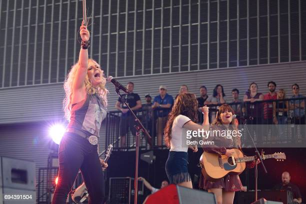 Natalie Stovall Kelleigh Bannon and Ruthie Colins of the band '3 Girls Rock into A Bar' perfom on the Cracker Barrel Stage during CMA Fest on June 9...