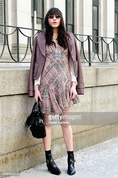 Natalie Suarez blogger of natalieoffdutycom seen wearing a smokey rose jacket and carpet print dress by Nanette Lepore Fall 2014 with her own vintage...