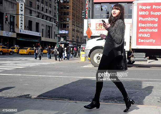 Natalie Suarez blogger of natalieoffdutycom seen wearing an alpaca turtleneck sweater by Nanette Lepore Fall 2014 with her own J Brand jeans Modern...